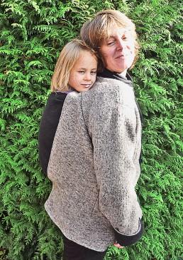 Manteau pour porter un enfant dans le dos